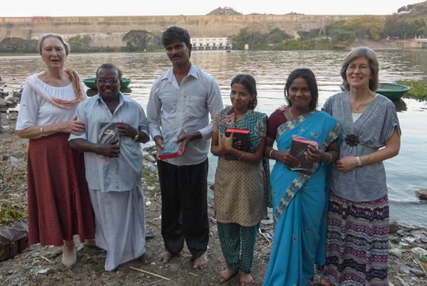 Group of baptised believers beside lake