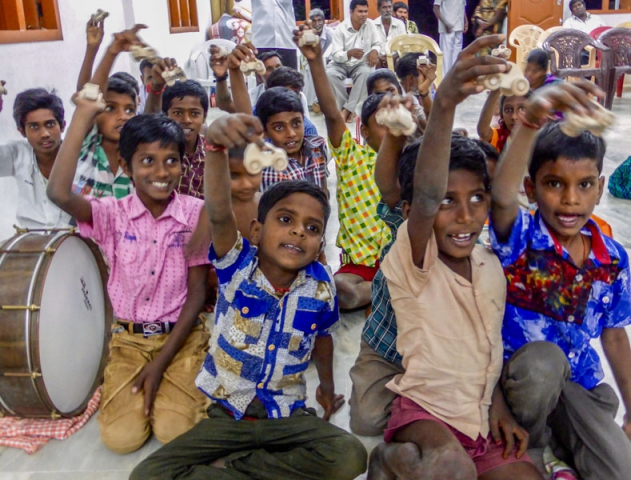 Happy children with toy gifts during rural church service in India