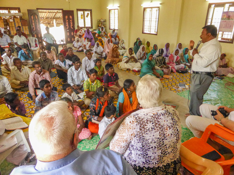 Pastor Solomon gives children talk in rural church service in India