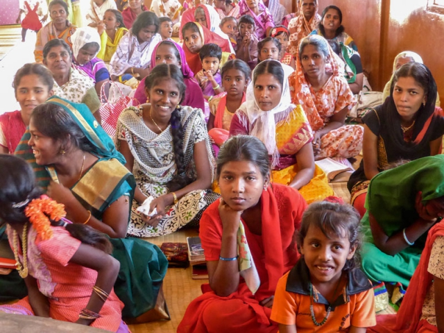 Colourful ladies at rural church service in India