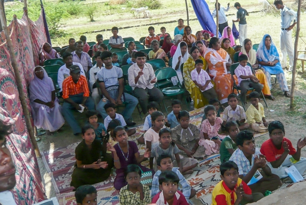 Church congregation in rural village