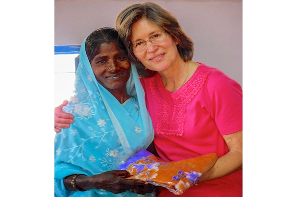 Kym giving sari to thankful widow in India