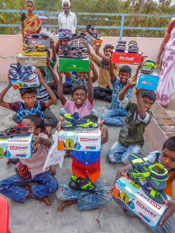 Happy orphans having received new shoes