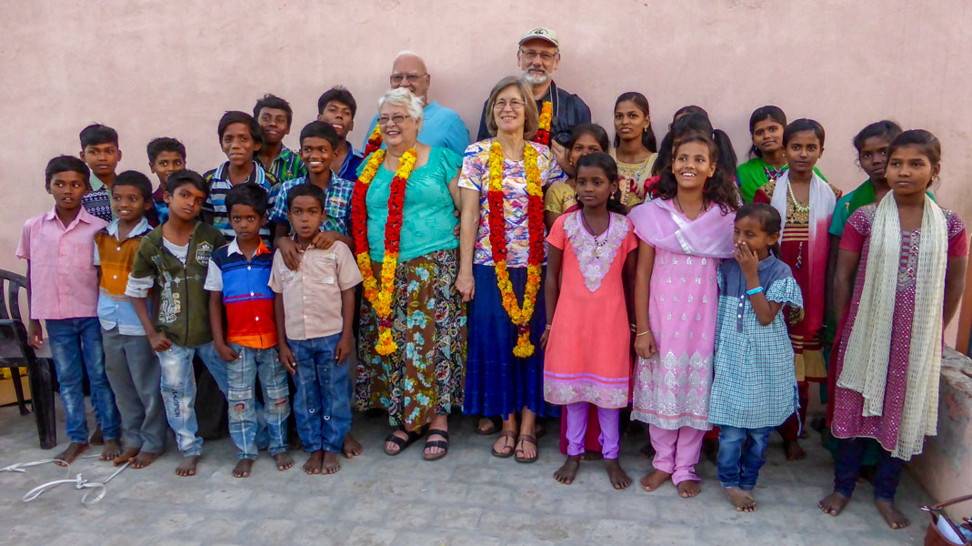 Group photo of Mission Team with happy orphans