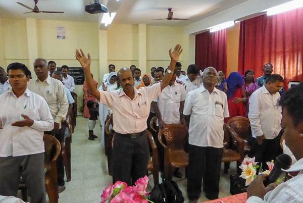 Pastors in prayer at a meeting