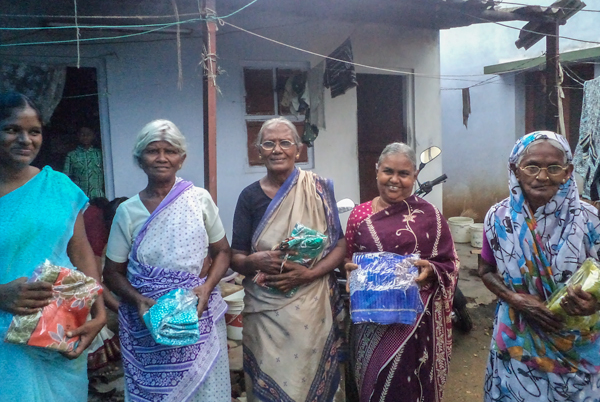 Elderly widows holding their new saris in rural India