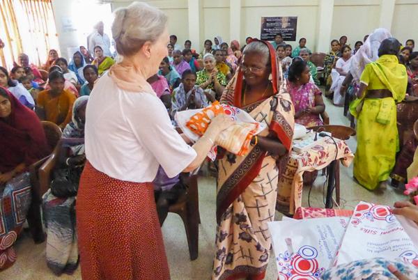 Smiling widow receiving her new sari