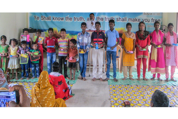 Indian children with gifts at holiday bible club