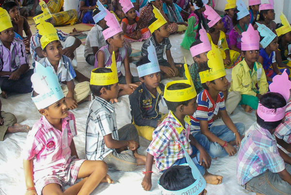 Indian Children wearing craft hats at holiday bible club
