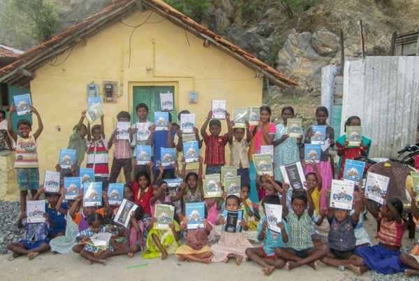 Happy Indian children gathered with VBS work books