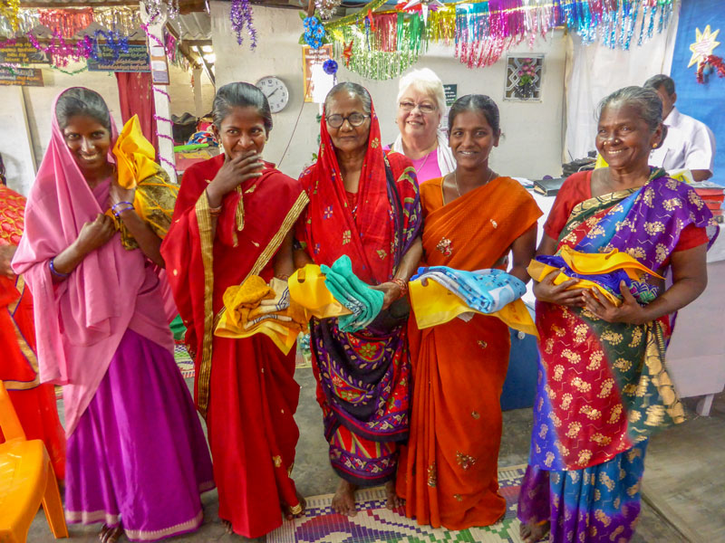 Grateful widows holding their new saris