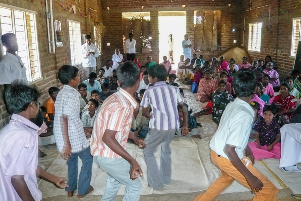 Boys dancing in rural church service