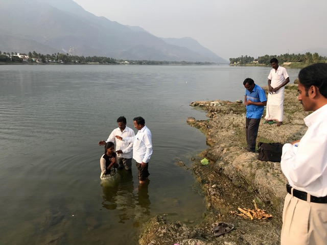 Riverside baptism of a new believer