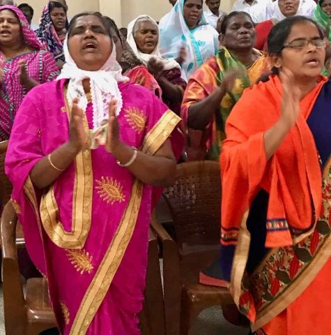 Ladies in worship during pastors meeting