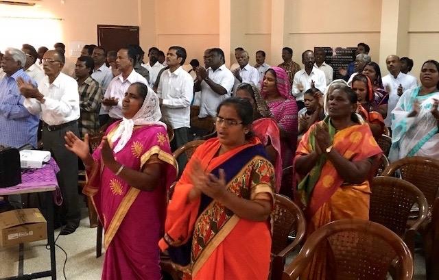 Pastors in worship during pastors meeting