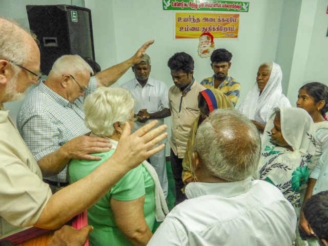 Prayer group after rural church service in India