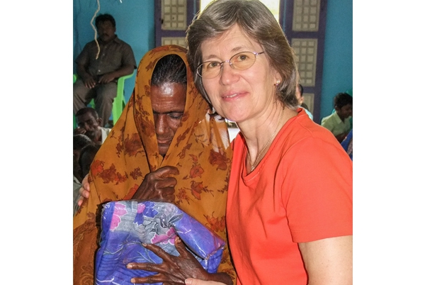 Kym giving sari to elderly widow in India