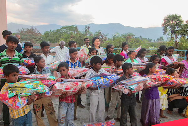Singapore Mission Team together with happy orphans holding gifts
