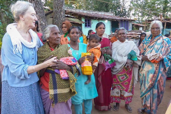 Ladies from a tribal village holding new saris