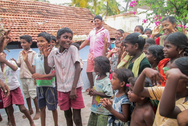 Happy tribal children singing in India