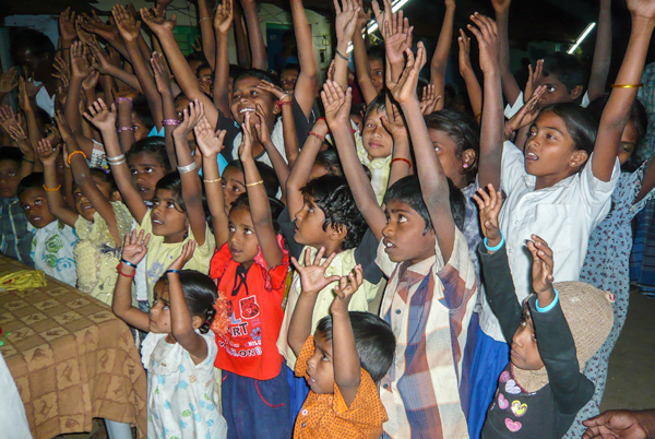 Rural village children in worship