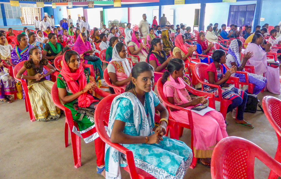 Happy young people attending a Youth meeting