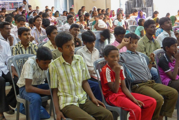 Young people attending a youth meeting