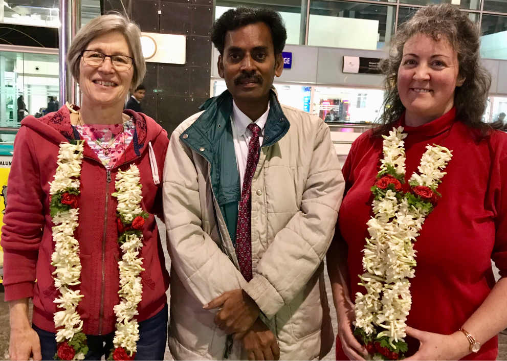 Pastor David greets mission team with garlands at Bangalore airport