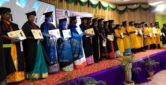 Micah Bible college students holding their certificates during graduation ceremony