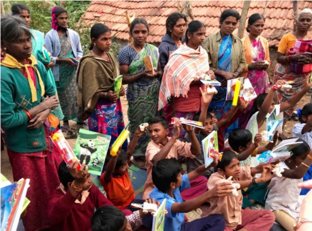 Tribal outreach villagers holding their gifts
